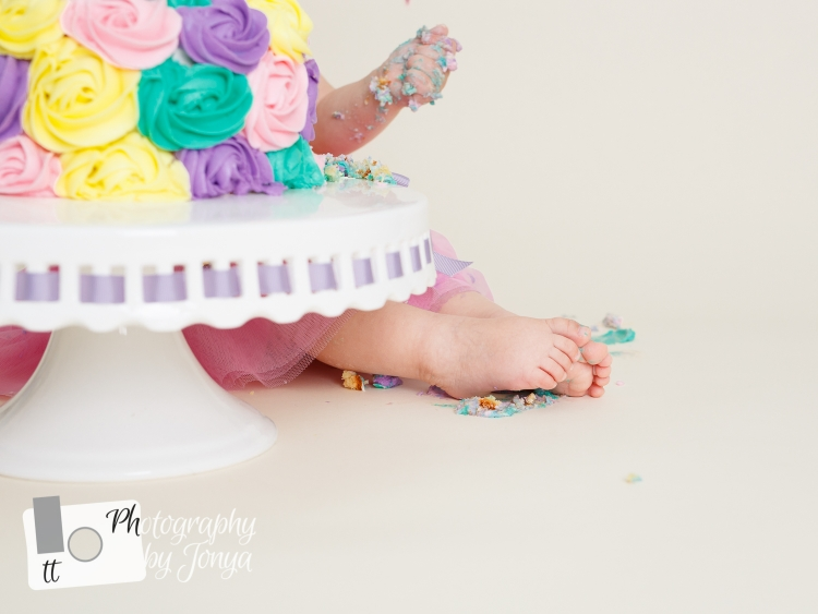 Girl cake smash photo during photoshoot in Raleigh NC