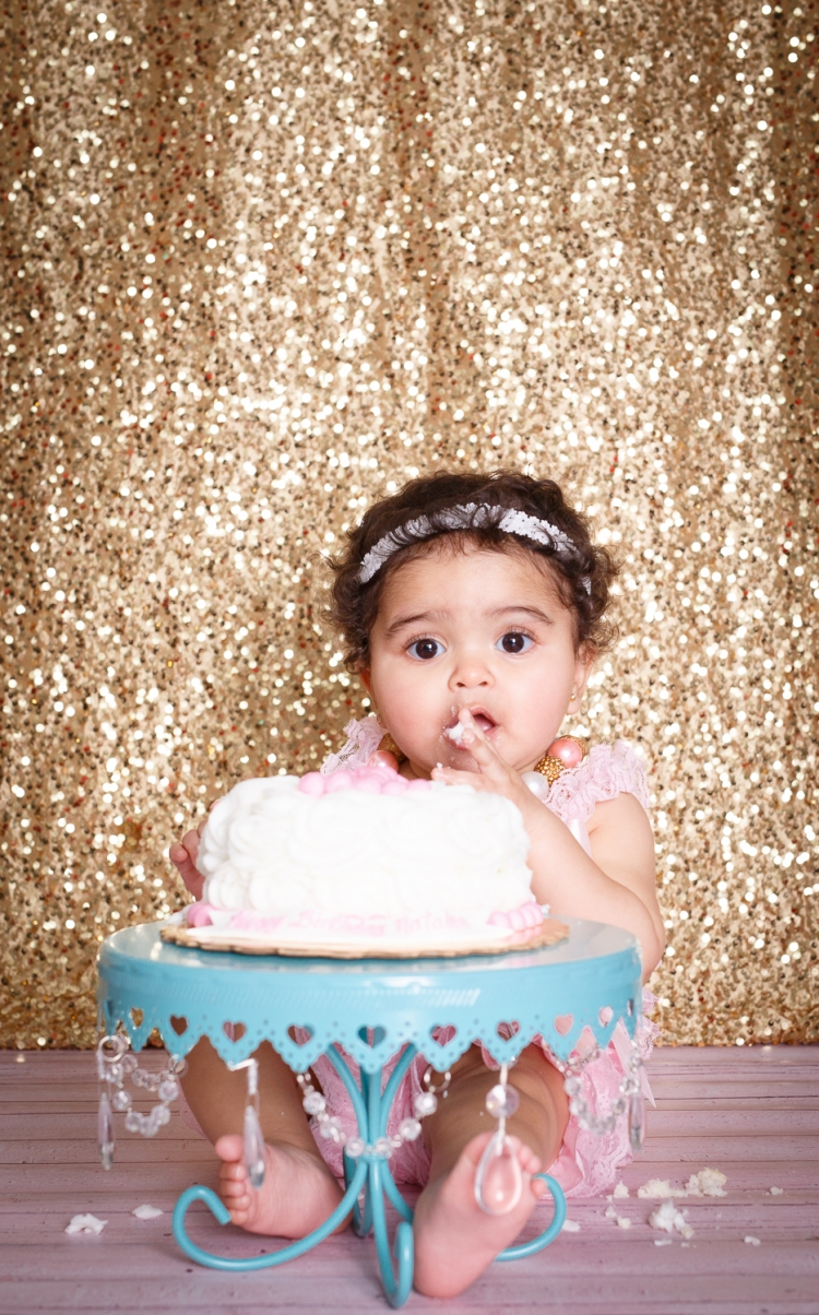 Cake smash session with gold seqence backdrop