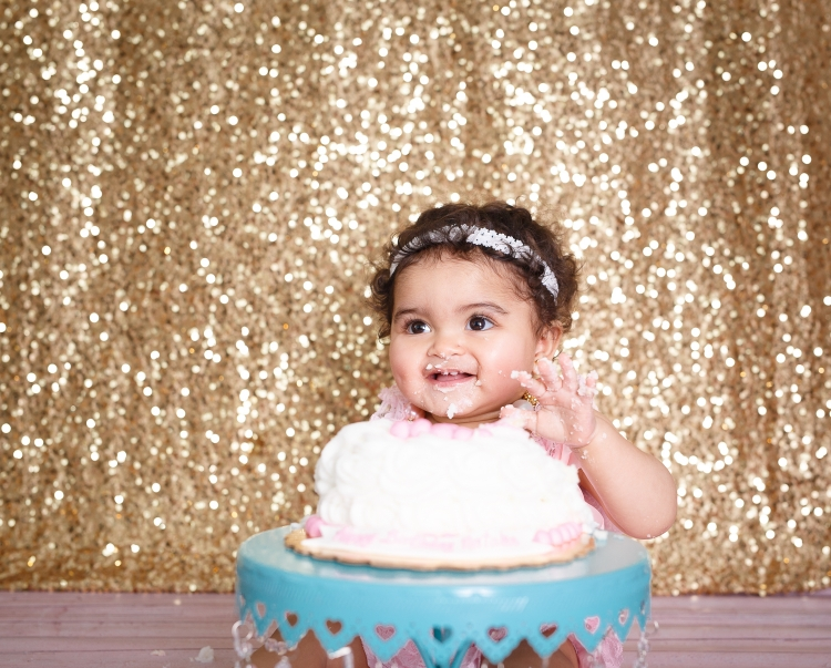 Cake smash photography with pink and gold