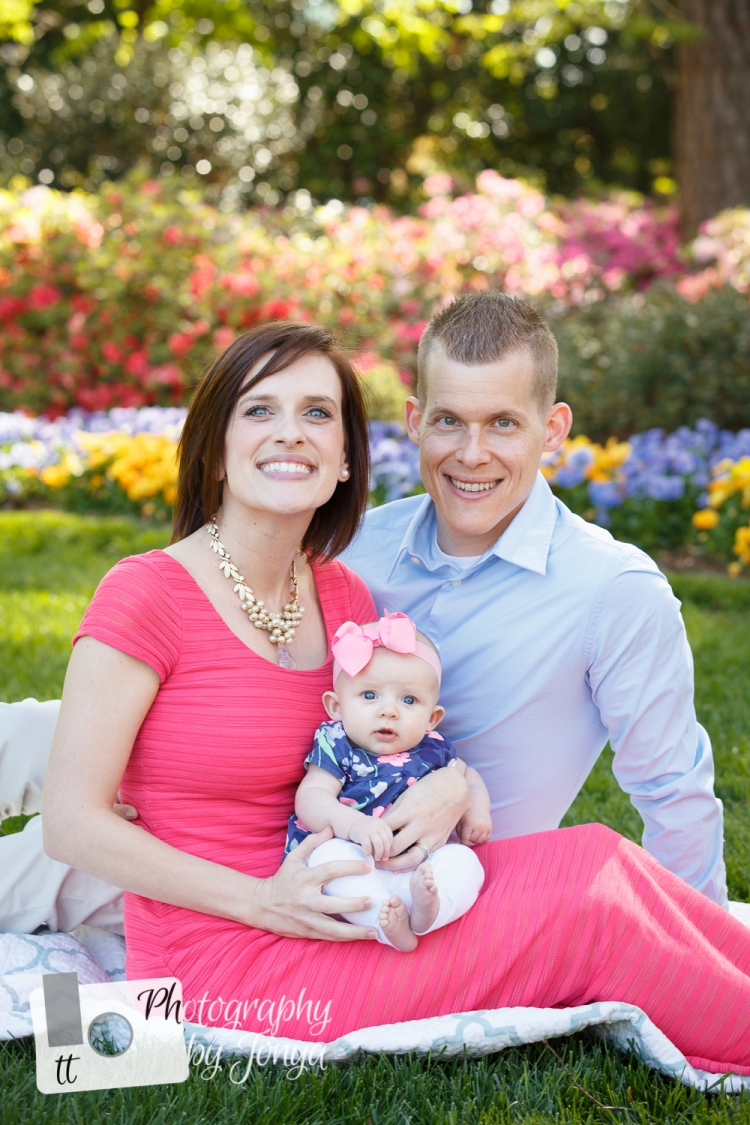 WRAL family photographer, family of three with pink