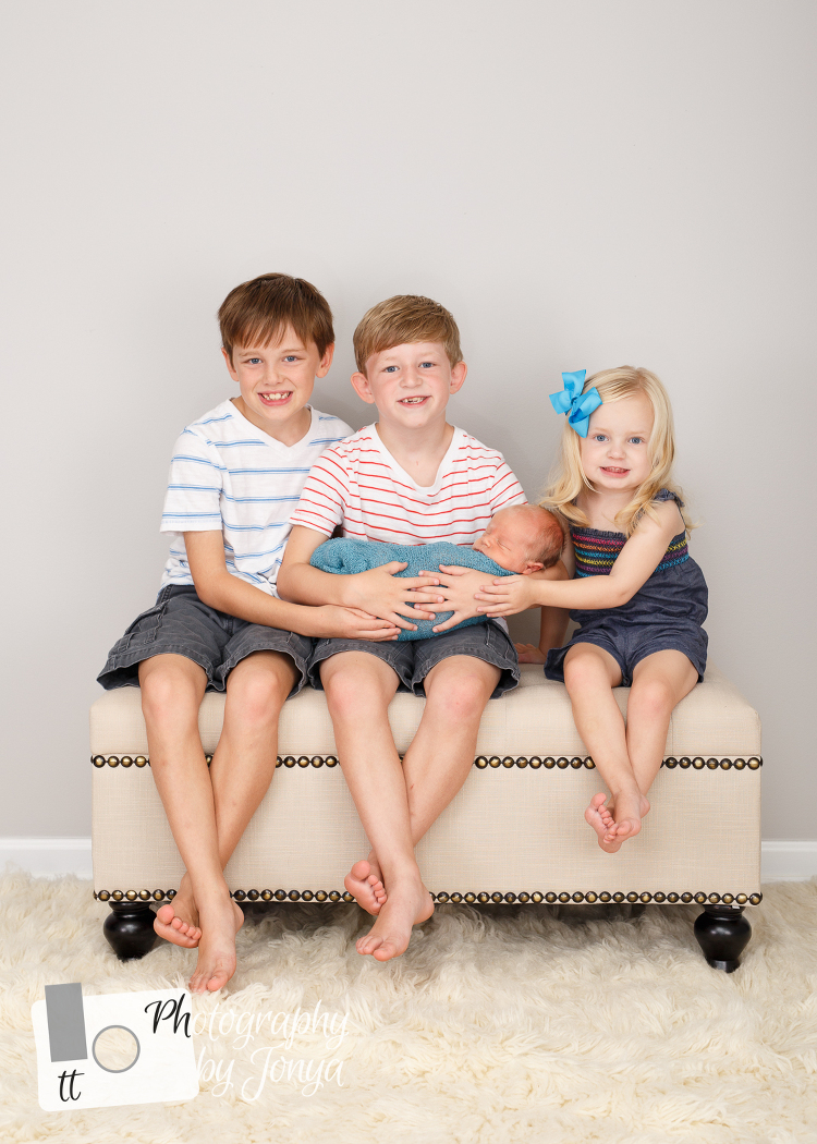 Newborn photography with siblings in Raleigh NC